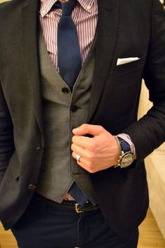 Choose a black blazer and navy trousers for drinks after work.   Shop this look on Lookastic: https://lookastic.com/men/looks/blazer-waistcoat-dress-shirt/17010   — Burgundy Vertical Striped Dress Shirt  — Navy Tie  — White Pocket Square  — Olive Waistcoat  — Black Blazer  — Navy Leather Watch  — Navy Chinos