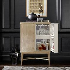 The faux-shagreen Seymour cabinet from Williams-Sonoma oozes Old Hollywood glamour; $2,995. williams-sonoma.com