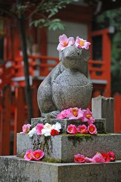Guardian Mouse Statue at Otoyo-Jinja in Kyoto- the ball of water it carries represents an abundance of good health, luck, love and long life.