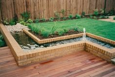 A raised water feature with low deck. Can change around to be a raised flower bed. A raised water fe Water Pond, Water Garden, Ponds Backyard, Backyard Landscaping, Backyard Ideas, Pond Design, Garden Design, Outdoor Projects, Garden Projects