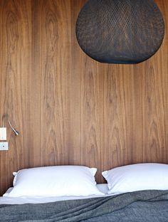 wood wall, mesh light fixture
