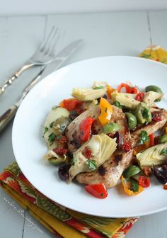 A delicious low carb recipe for grilled chicken served with a heart healthy, Mediterranean-inspired salsa topping. Perfect for summer entertaining!