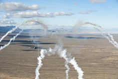 U.S. Air Force C-17 Globemaster IIIs deploy flares while flying over the Nevada Test and Training Range while participating in the U.S. Air Force Weapons School's Joint Forcible Entry Exercise 14B Dec. 6, 2014. When USAFWS students graduate as weapons officers, they will go back to their units and share that knowledge and their experiences from JFEX, to better prepare the Air Force operate in any contingency. (U.S. Air Force photo by Senior Airman Thomas Spangler)