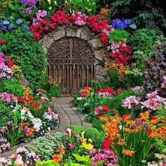 Beautiful gate in garden - and oh my - what a garden!