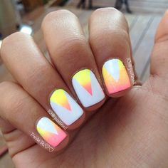 V-shaped gradient themed nails in yellow and pink color combination.
