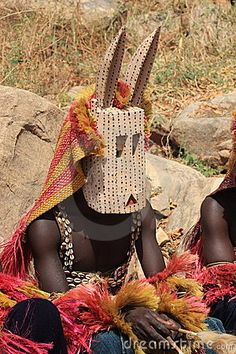Dogon mask, during traditional funerary rites. The Dogon live in the central plateau region of Mali, south of the Niger bend in the Mopti region. They number just under 800,000. Photo by milsaus (dreamstime)