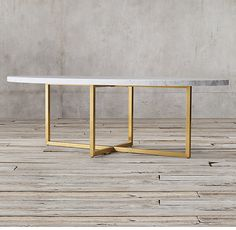 Oval Torano marble dining table RH's Torano Marble Oval Dining Table:Designed by Timothy Oulton, our table exemplifies the cool minimalism of Italian design. Torano juxtaposes an austere metal frame with a clean-edged, polished marble top.