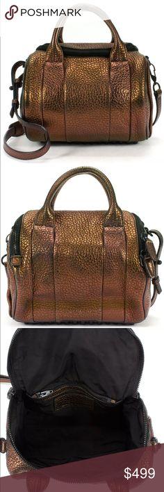 "Alexander Wang Rockie Metallic Bronze Exterior: Genuine Leather Interior: Nylon Measurements 9.5"" Length, 8"" Height, 3.25"" Depth Handle Drop: 2"" Strap Drop: 17"" Alexander Wang Bags Satchels"