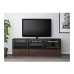 """IKEA - BESTÅ, TV bench with doors and drawers, white/Valviken gray-turquoise clear glass, drawer runner, soft-closing, 70 7/8x15 3/4x25 1/4 """", , The drawers and doors close silently and softly, thanks to the integrated soft-closing function.You can control your electronic equipment with the doors closed, as the remote control works through the glass.It's easy to keep the cords from your TV and other devices out of sight but close at hand, as there are several cord outlets at the back of the…"""