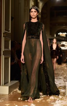 This sheer deep green gown is breathtaking.