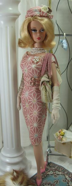 A classic sheath cut from a  stunning Japanese cotton/linen fabric in pastel rose, fully lined, with scoop neckline, double belts and buckles at the midriff, plunging back neckline  and button over snap back closure. The matching pillbox hat if fully lined with turned up brim and finished with dressmakers bow, china silk rosettes and stemens. The shopper is stripped cotton fully lined with gold-tone hardware, chain shoulder strap and handles and front flap with snap closure. NOTE...THE ...