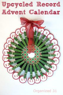 upcycled 45 record advent calendar, christmas decorations, crafts, decoupage, seasonal holiday decor, A Rockin Advent Calendar from a thrifted 45 record some clothespins and Glitter Mod Podge for under 5