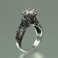 This ring is fantastic! The ENCHANTED PRINCESS Moissanite 14K gold by WingedLion on Etsy, $2435.00 by debra