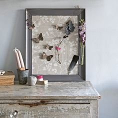 Turn an old picture frame into a pinboard with this speedy craft idea