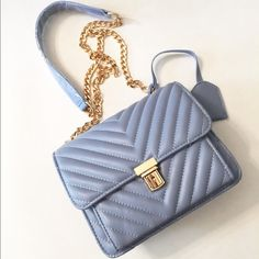 🎉Sale🎉Cute handbag/crossbody bag (baby blue) New without tag. Never used or worn. Still has the plastic wrap on the strap. Size approx: 20cm x 8cm x 16cm (7.87'' x 3.15'' x 6.3'') Bags Crossbody Bags