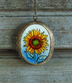 Sunflower -- Floral Watercolor Painting Art Locket by Sarah-Lambert Cook http://www.etsy.com/listing/104262461/sunflower-floral-art-locket-artisan-boho?ref=v1_other_1