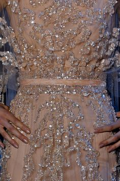 Incredible embellishment on this pale blush wedding dress.