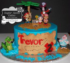 "Jake & the Neverland Pirates - 8"" cake iced in buttercream w/fondant map & palm tree. The Jake Pirate figures were provided by the customer. TFL!"