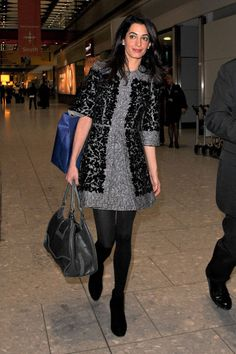 Arriving back in London after a trip to Geneva in 2014. See all of Amal Clooney's best looks.