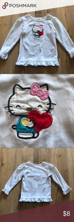 Boutique hello kitty hearts Tee Boutique white knit longsleeve T with ruffle him and sleeves. Embroidered hello kitty appliqué hugging the heart. In really great condition except for two small marks on sleep see last picture. Size 6. One of a kind. #Valentine'sDay #valentines #valentine #vday #hearts Shirts & Tops Tees - Long Sleeve