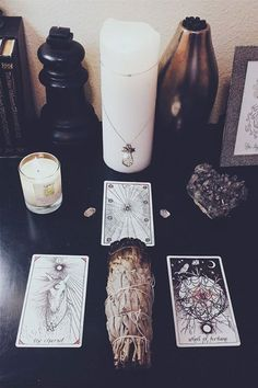 altar: white pillar candle + talisman + sage + Tarot candles
