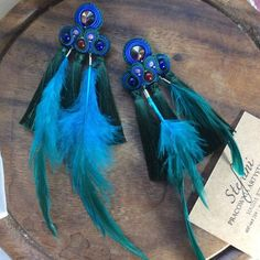 long peacock feather earrings with tassel, forest green fringe earrings with purple crystal, statement jewelry for bold women, artist gift Soutache Earrings, Fringe Earrings, Feather Earrings, Blue Earrings, Ankle Tattoos For Women Anklet, Wood Bracelet, Hand Jewelry, How To Apply Makeup, Statement Jewelry