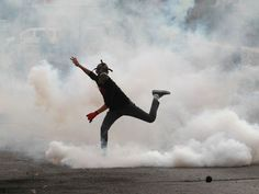 A Palestinian protester throws a tear gas canister back toward Israeli security forces at the main entrance of the West Bank city of Bethlehem.  Musa Al-Shaer, AFP/Getty Images