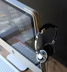 If you are going to attach something to that iMac it might as feel be a as beautiful!!!    MacHook by WorkerMan