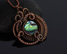 This handicrafted fantasy pendant with beautiful iridescent mother of pearl in aged copper will definitely stand out. Absolutely love how the light plays with the colours of the abalone (paua) shell, so it almost glows blue, then mysterious green, then all turns into shades of purple