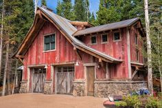 This is a cute garage and guest house with red-painted barnwood siding and barnwood garage doors.