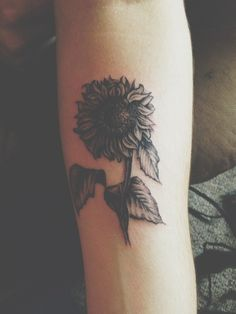 amazing sunflower tattoo. I love how it's black and gray, although I'd add a little touch of yellow to shade in with the gray in some spots..then it would perfect in my opinion.