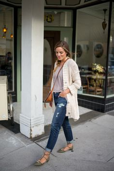 Shop this look on Lookastic:  http://lookastic.com/women/looks/cardigan-v-neck-t-shirt-skinny-jeans-pumps-crossbody-bag/10288  — Beige Knit Cardigan  — Grey V-neck T-shirt  — Navy Skinny Jeans  — Olive Studded Leather Pumps  — Tobacco Leather Crossbody Bag