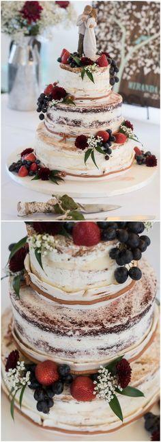 Rustic wedding cake, naked cake, strawberries, blueberries, bride & groom cake topper, three tiers, white flowers // Alexander Rubin Photography