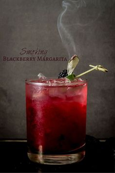 Smoking Blackberry Sage Margarita | This spooky cocktail recipe is a must-try for your halloween cocktail party.