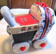 Baby shower diaper carriage....I like the idea of using a basket. - Did this for my sisters baby shower - it was a pain and took forever since there are no instructions! But it came out just as nice and everyone LOVED it!