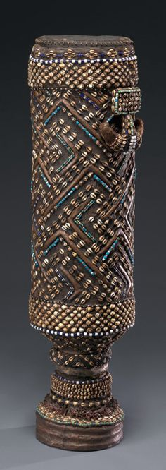 Africa | Pelambish (Royal Drum) from the Kuba people of DR Congo | Early 20th century | Wood, glass beads, cowrie shells, hide, metal, fur, resin