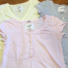 ⚡️Flash Sale⚡️Casual t shirts 3 casual t shirts. Yellow one is v neck, pink one is round scoop neck with buttons and a small pocket, gray one is round scoop neck with buttons and a small pocket. All are size xl but for like a small Abercrombie & Fitch Tops Tees - Short Sleeve