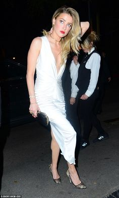 Smokin': Amber Heard, 30, sizzled in a plunging white gown as she attended the WME Nominee...
