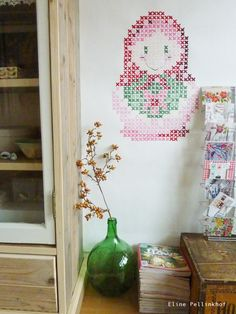 Such a cute idea: painted cross-stitch on the wall. You could just re-size a template for this... #art #home #DIY