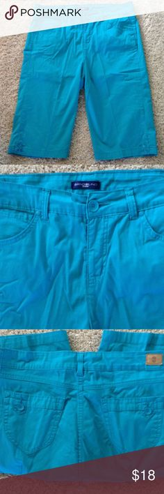 Turquoise shorts Excellent condition. The color is more turquoise than the photo shows. 97%cotton, 3% spandex. 37 inch waist, 14.5 inch inseam. These go with the Bandolino print tiered sleeveless top with crochet at the top. Bandolino Shorts Bermudas