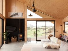 A compact house near Queenstown is full of interesting angles. It's not often that a house is compared to the Tardis in Doctor. Interior Architecture, Interior And Exterior, Interior Design, Traditional Sheds, Plywood Ceiling, Plywood Interior, Compact House, Facade House, Concrete Floors