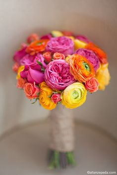 #brightwedding #colorfulwedding #citruswedding. To view our colorful Ranunculus:  http://www.afloral.com/Silk-Flowers-Artificial-Flowers-Fake-Flowers?search=ranunculus Bright Citrus Ranunculus Wedding Bouquet via http://www.stylemepretty.com/destination-weddings/2011/06/01/elbow-beach-photo-shoot-by-dm-events-allan-zepeda/