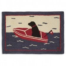 Black Lab Sea Dog Rug Designed By Laura Megroz Is Featured In A Red Boat On The Open Or Lake