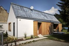 The Wooden Brick House adds contemporary detailing to the local village house architecture. It has 745 sq ft inside with one bedroom. Modern Wooden House, Wooden House Design, Modern Barn, Small House Design, Wooden Houses, Shed Design, Facade Design, Deco Design, Detail Architecture
