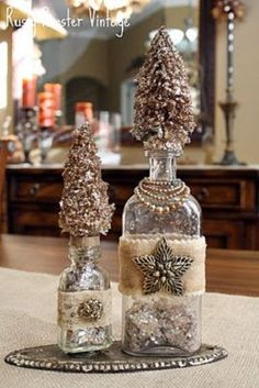 altered bottles with bling and bottle brush Christmas trees