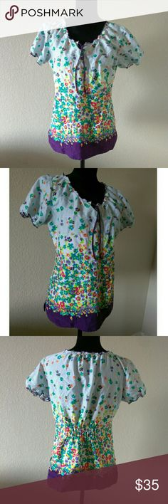 Floral Peaches Scrub Top Adorable and Soft Scrub Top by Peaches. Size Medium. Gently used good condition. Approx measurements are 18 inches chest, 25 inches length. Peaches Tops