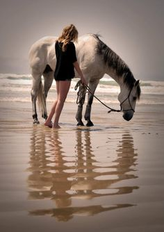 I just love everything about this! From the beach, to the horse, to the casualness of the photo to the way the sunlight hits them! Love love love!