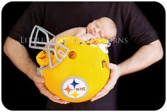 newborn photography baby in football helmet-a definite one day with Giants helmet of course