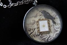 Made in honour of one of my favourite poets - Mr Edgar Allan Poe (and his Raven) 3D style pendant. Black coated metal watch case with antique background. Contains small patterned handmade crow (right facing) sitting on top of brass picture frame. Comes with long gunmetal chain.