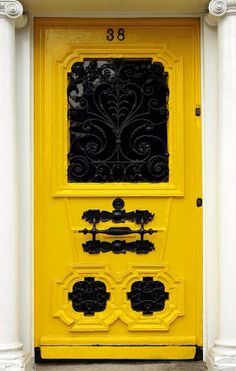 Dublin, Ireland. Vibrant colour contrast between door and furniture #ironmongery